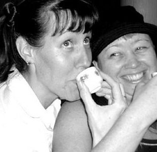 Joie and me at Sho Chiku Bai sake tasting, circa 2005. A wonderful day in our history. <3